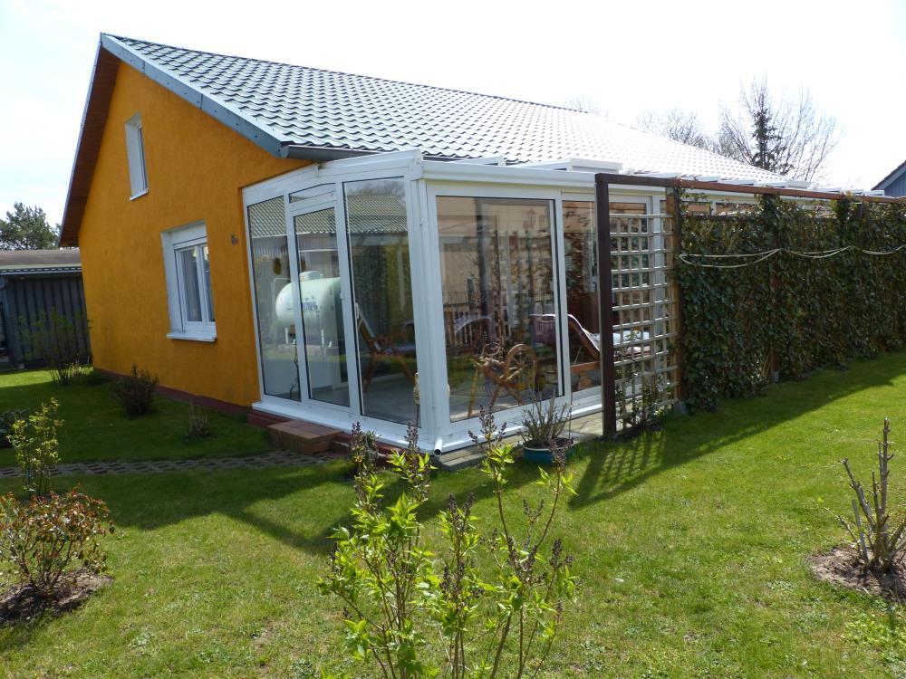 Grundstück mit Haus/Wintergarten